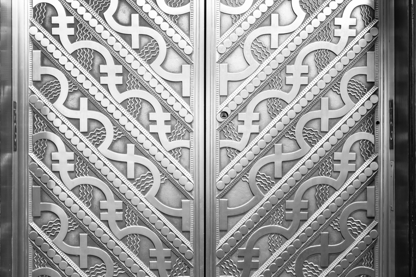 Pattern on gold elevator doors in Chicago